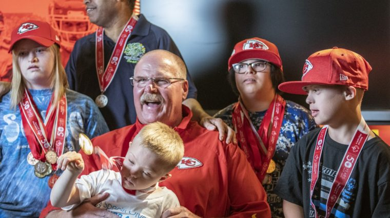 Coach Andy Reid poses with SOMO athletes