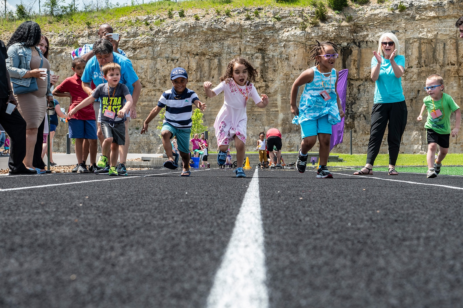 A group of young athletes break off the line during a track race