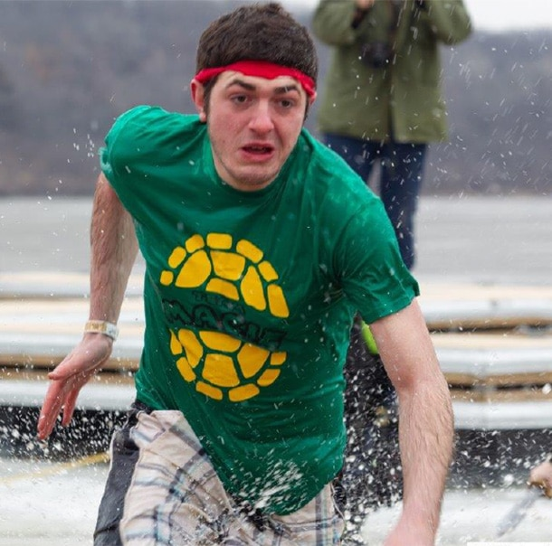 A Polar Plunger in a ninja turtle costume runs through the water