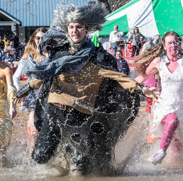 A Polar Plunger in a costume runs into knee-high water