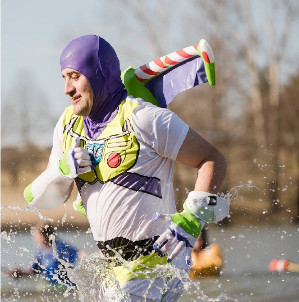A Polar Plunger in a Buzz Lightyear costume runs into the water