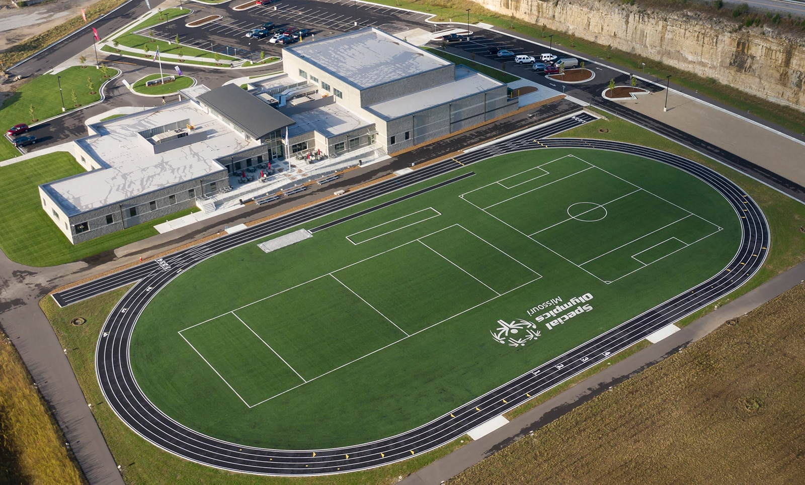 An aerial photo of the turf field and track at the Training for Life Campus