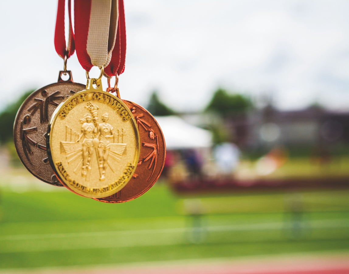 Color photo of three hanging medals