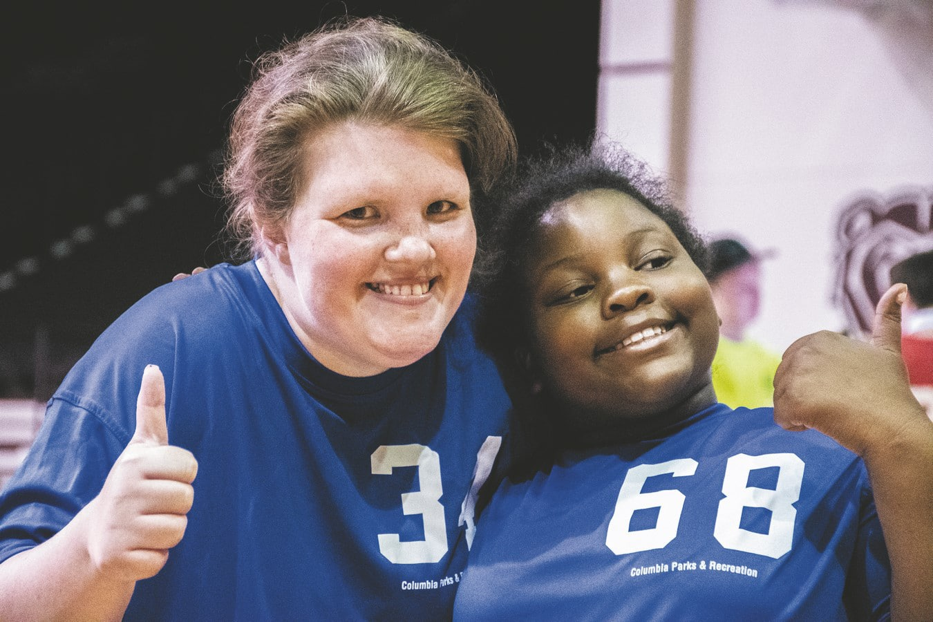 Two athletes from Columbia Parks & Recreation pose for a photo with their thumbs up