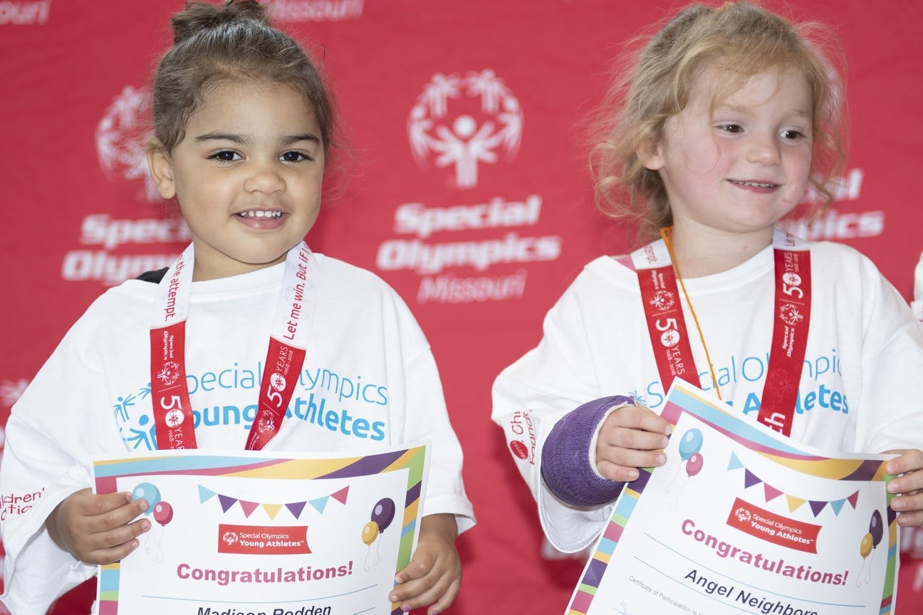 Two Young Athletes hold graduation certificates