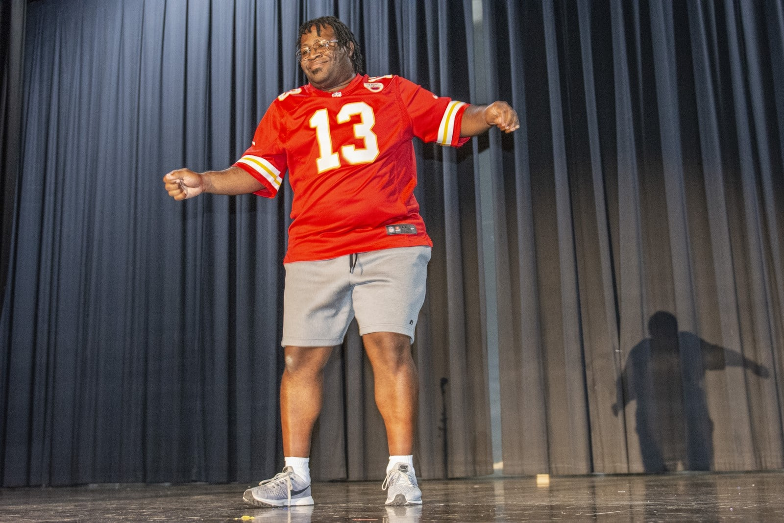 An athlete dances on stage during a talent show