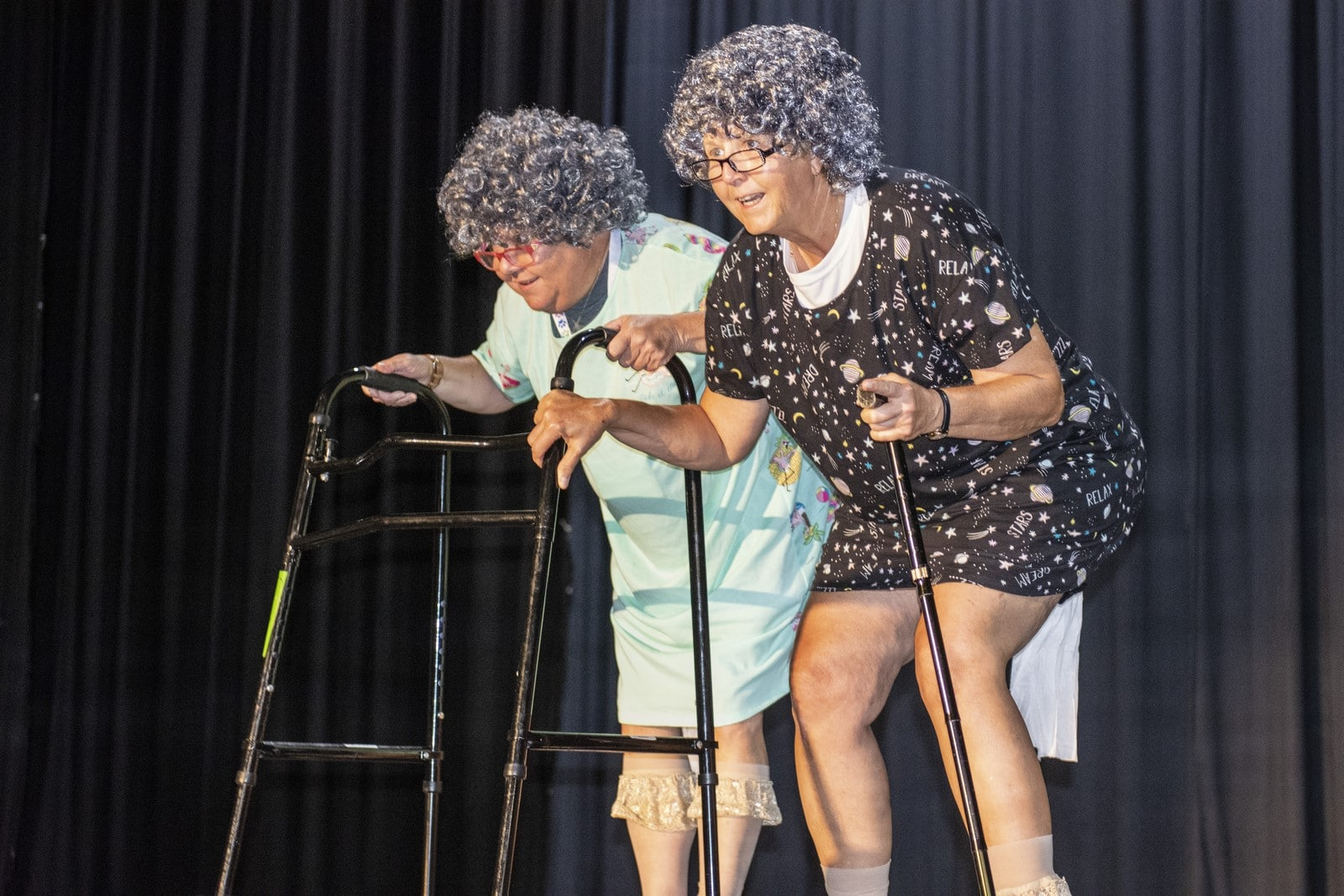 Camp staff dress up as the elderly in nightgowns and gray wigs