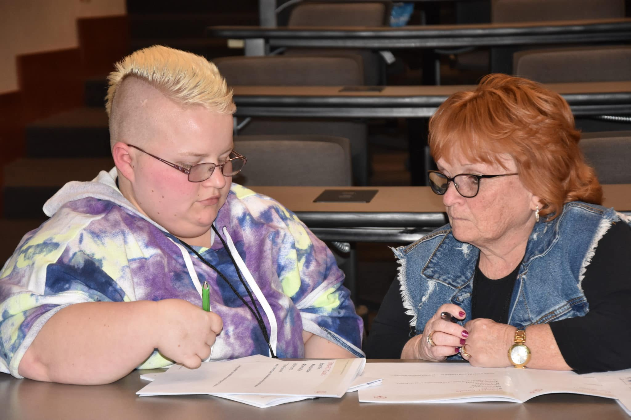 An athlete-leader and their mentor work together on their final project at an Athlete Leadership University