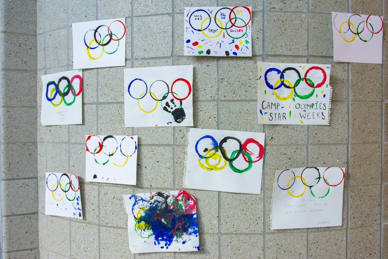 A collection of art hangs on the wall of the Training for Life Campus