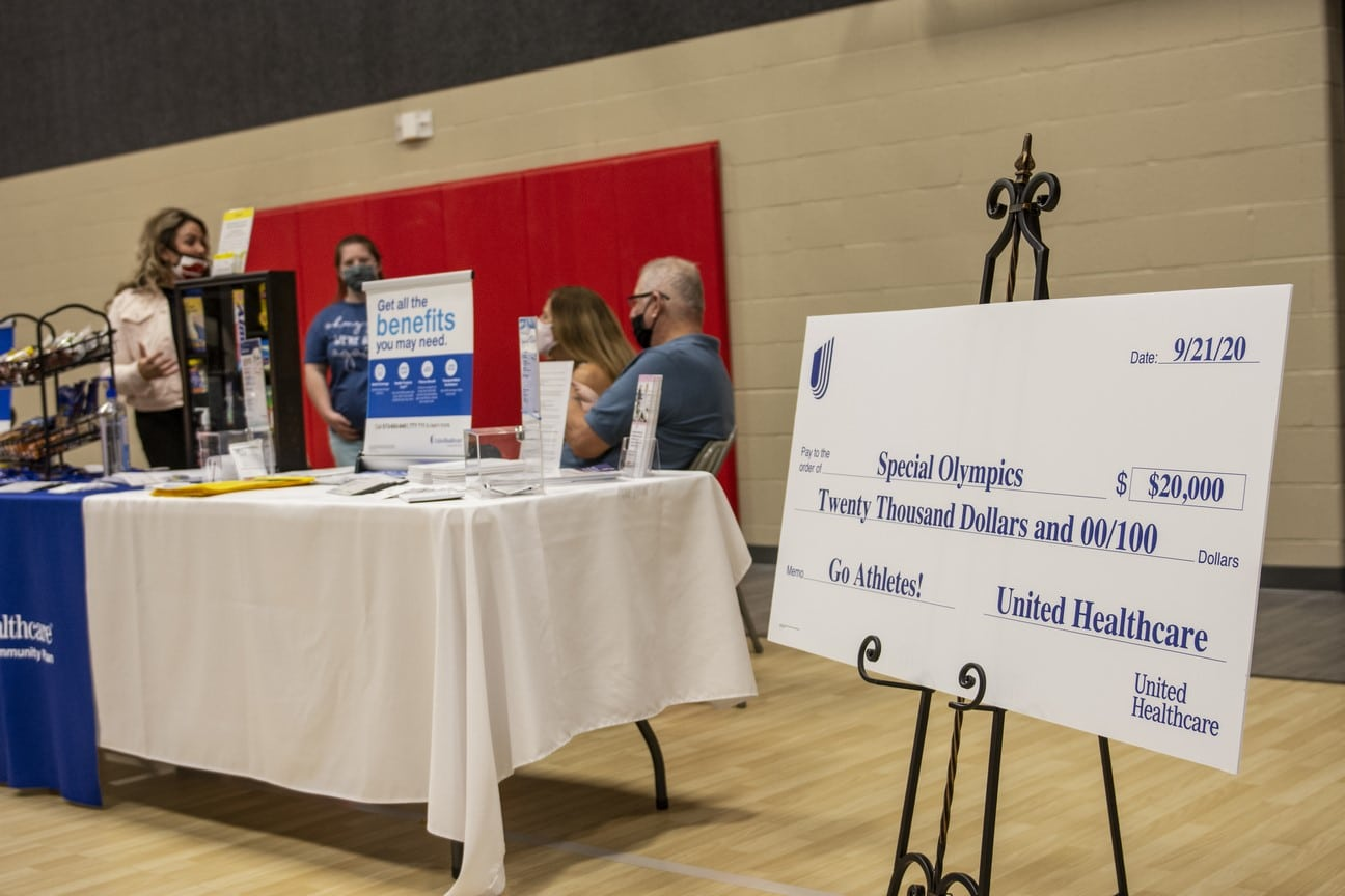 A $20,000 check from United Healthcare sits on a stand near a table