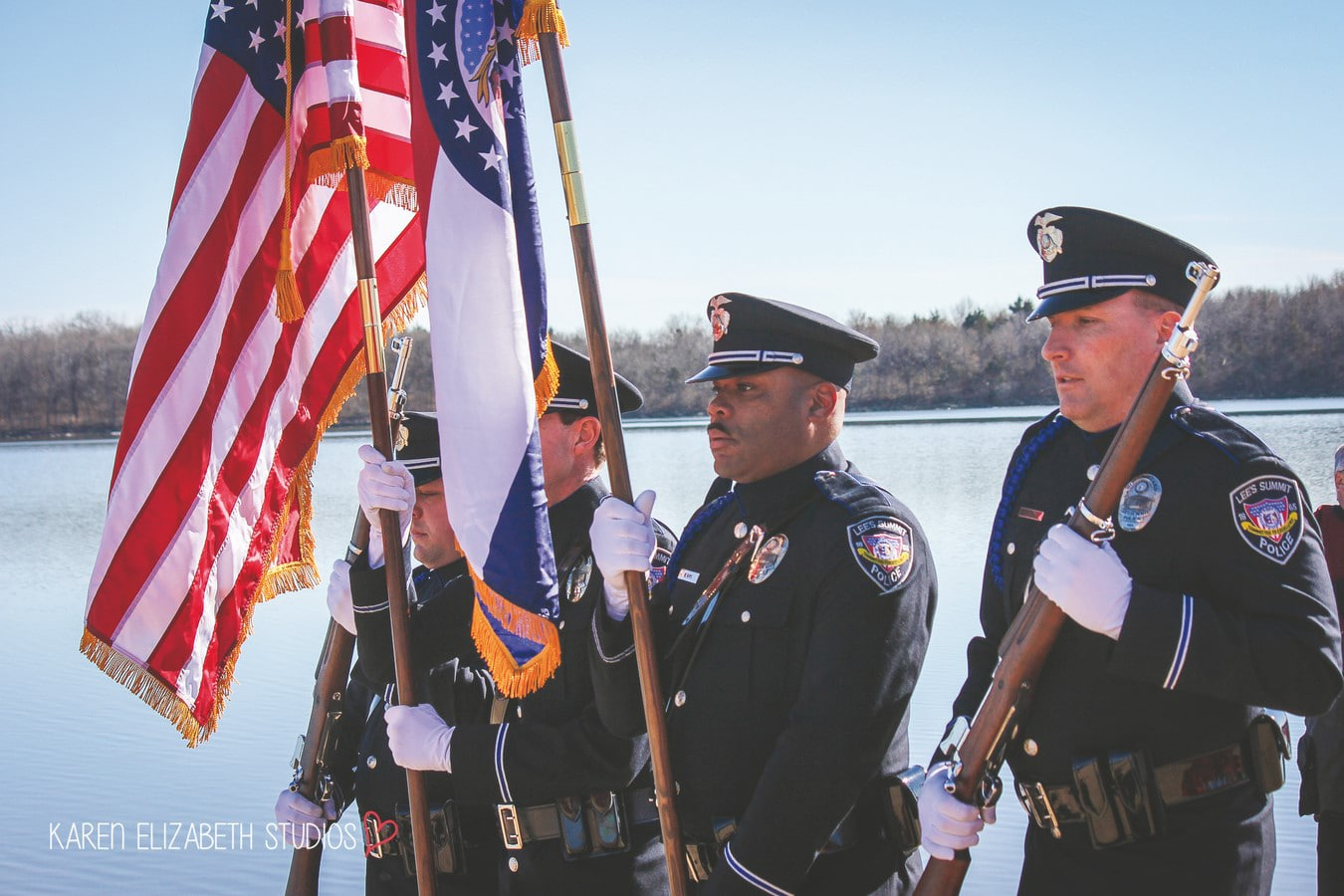Police Officers pose while holding flags and rifles for opening ceremony at the Plunge