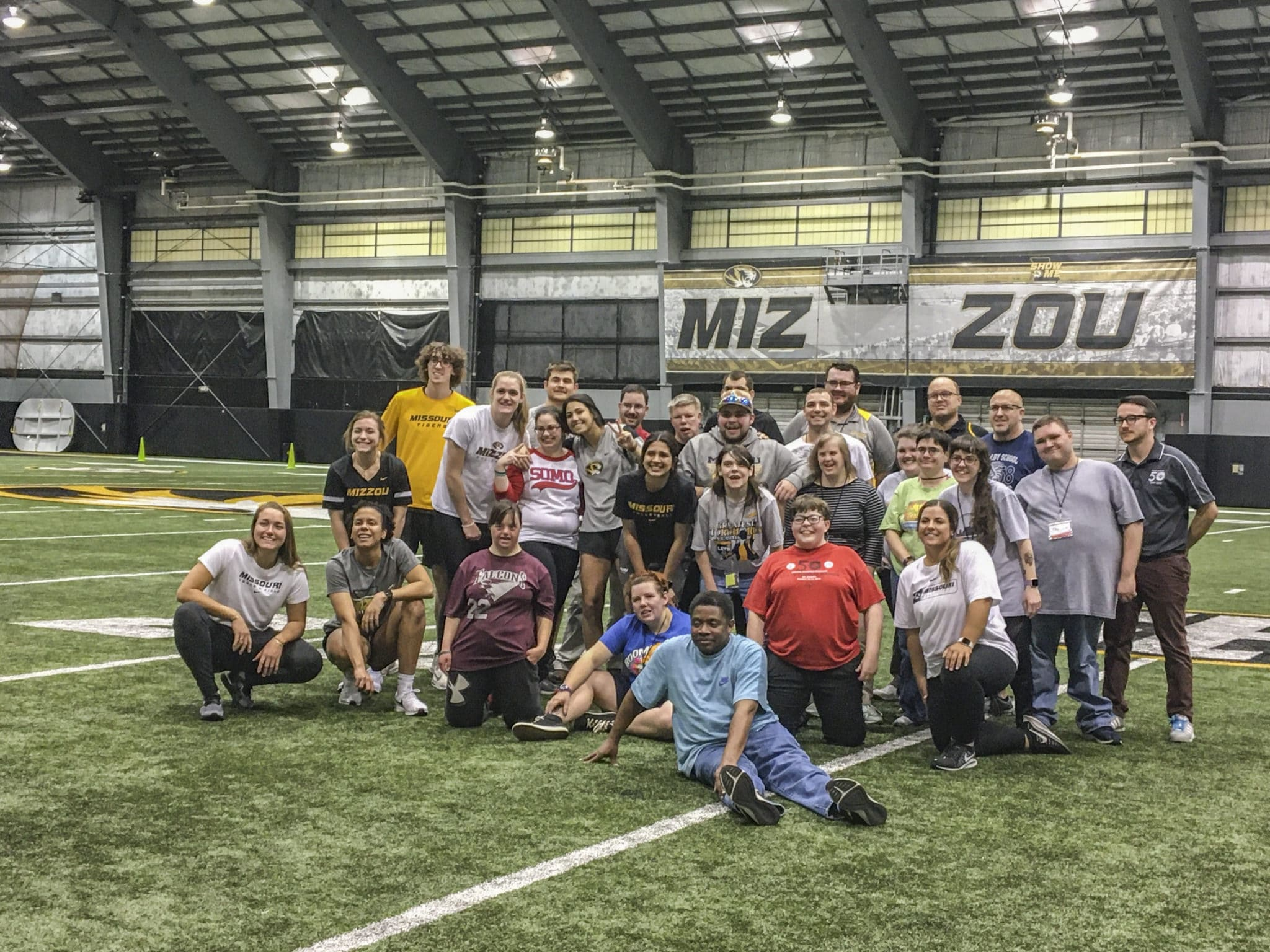 A group photo of athlete-leaders, mentors, and Mizzou student-athletes at the Mizzou Athletic Training Facility