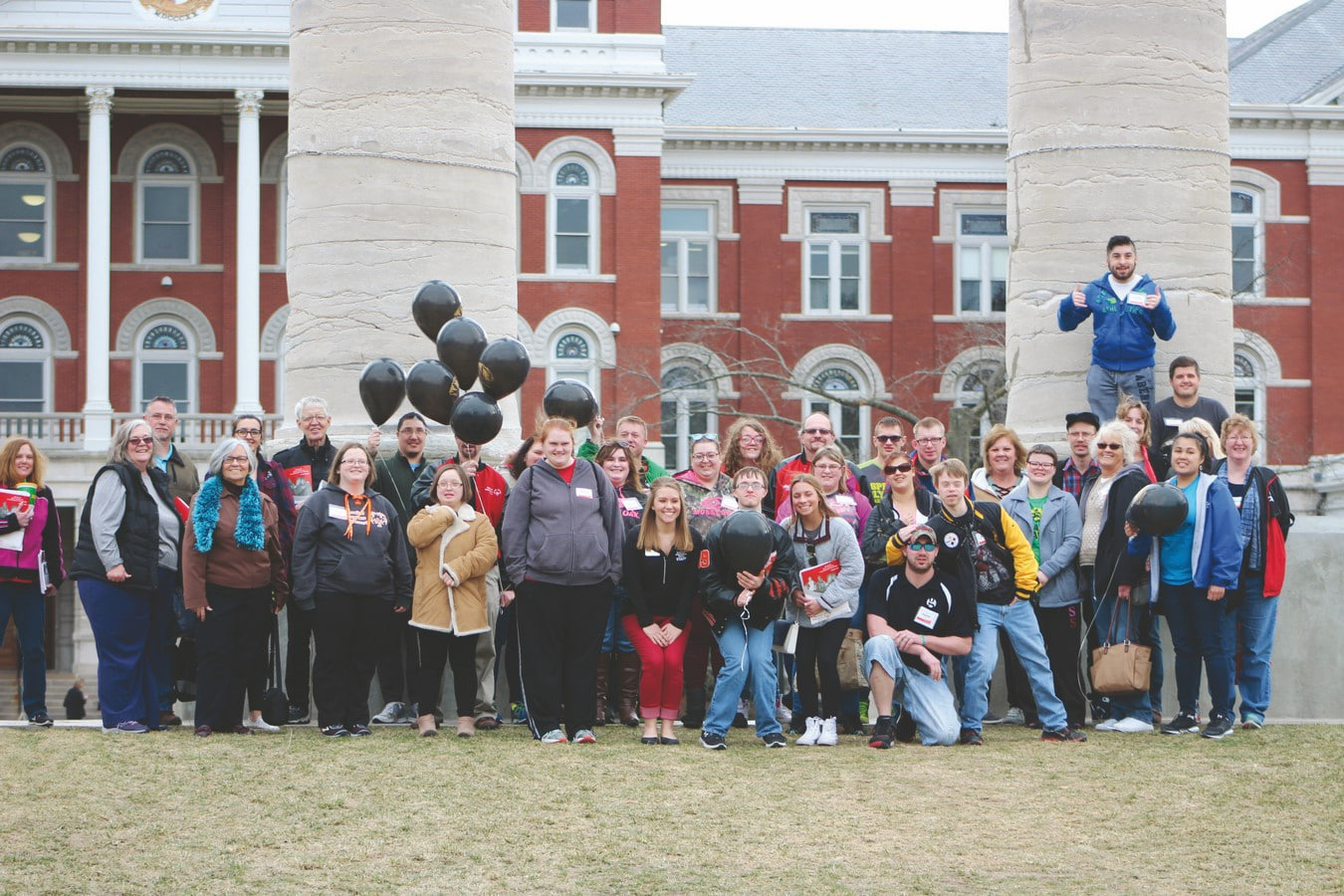 A group of 40 athletes-leaders and mentors pose for a photo in front of the famous Mizzou columns at an Athlete Leadership University