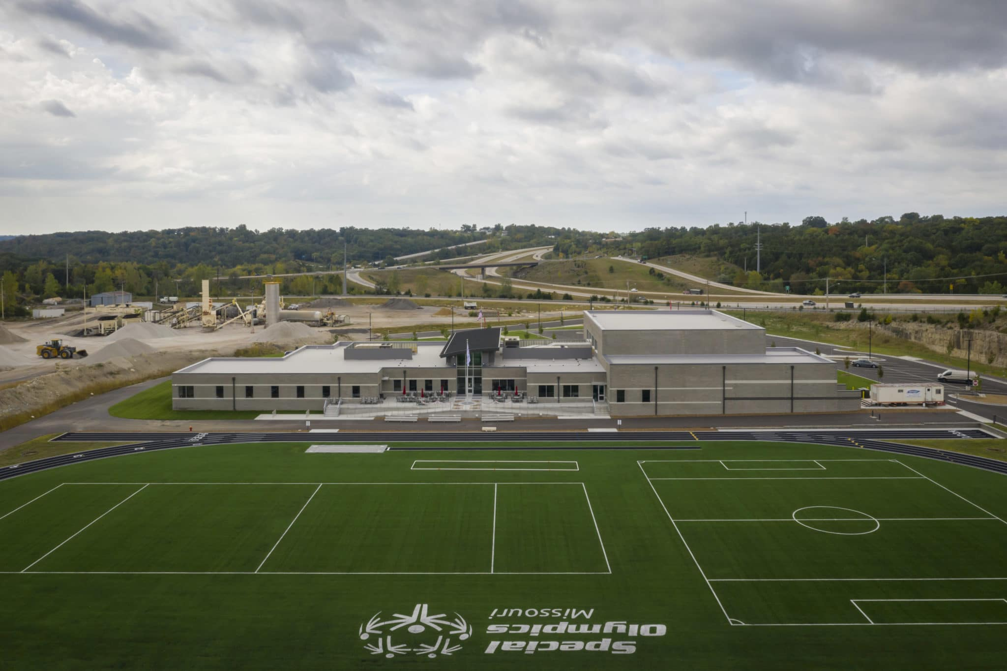 An aerial photo of the Training for Life Campus showing the turf field, track, and building