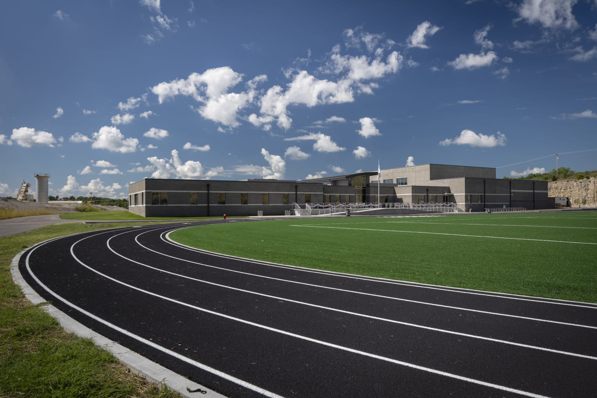 Exterior photo of the track and turf field at the Training for Life Campus