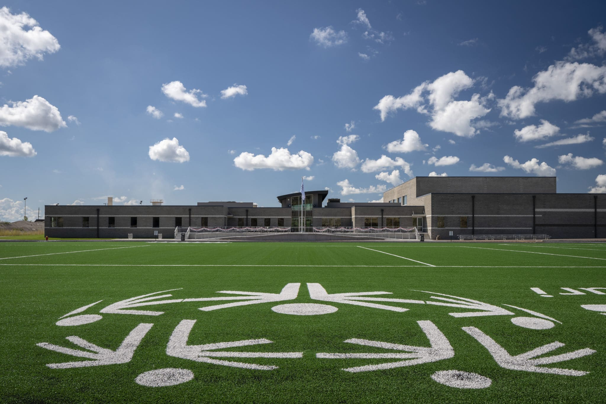 An exterior photo of the turf field at the Training for Life Campus