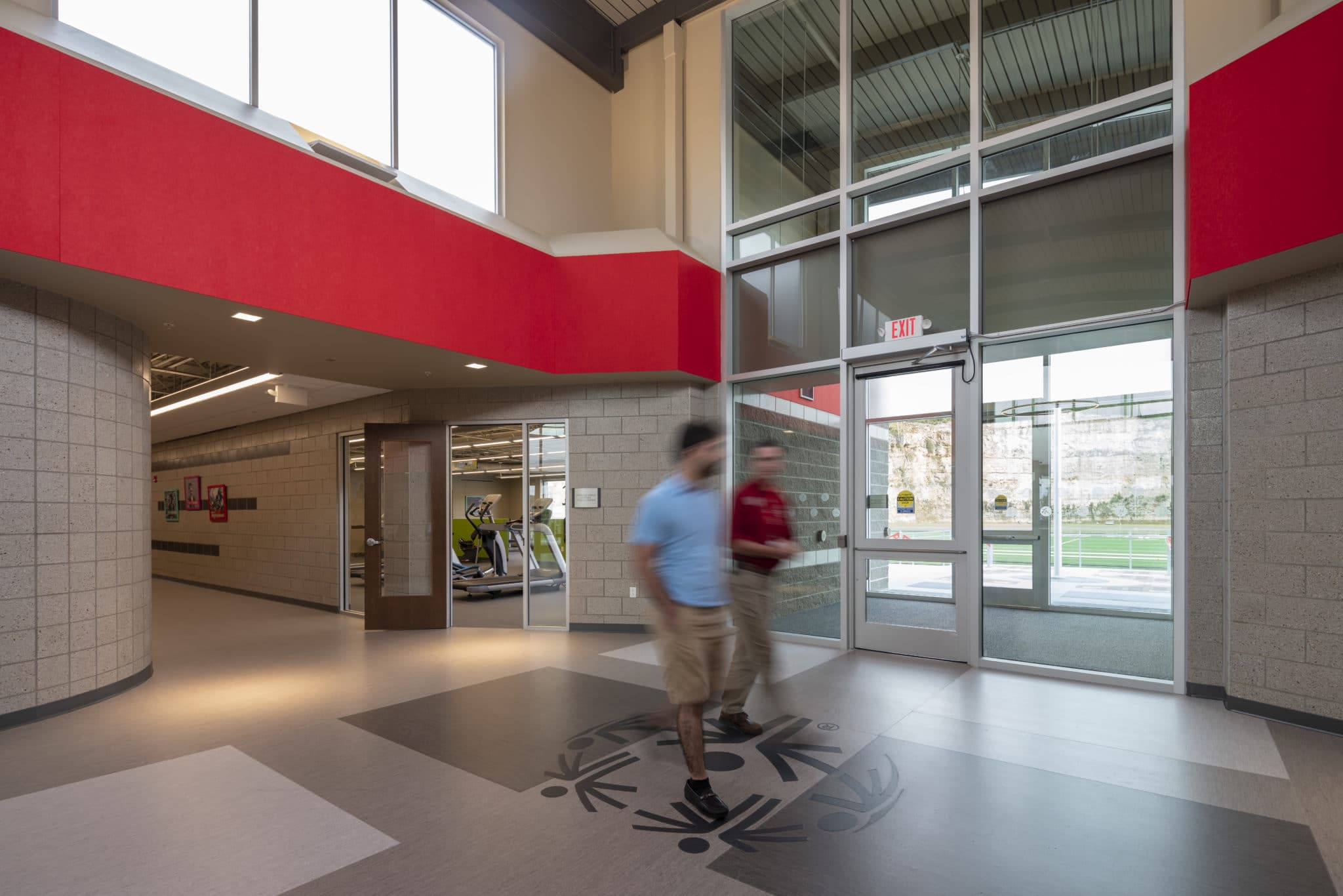 An interior photo showing two people walking through the halls at the Training for Life Campus