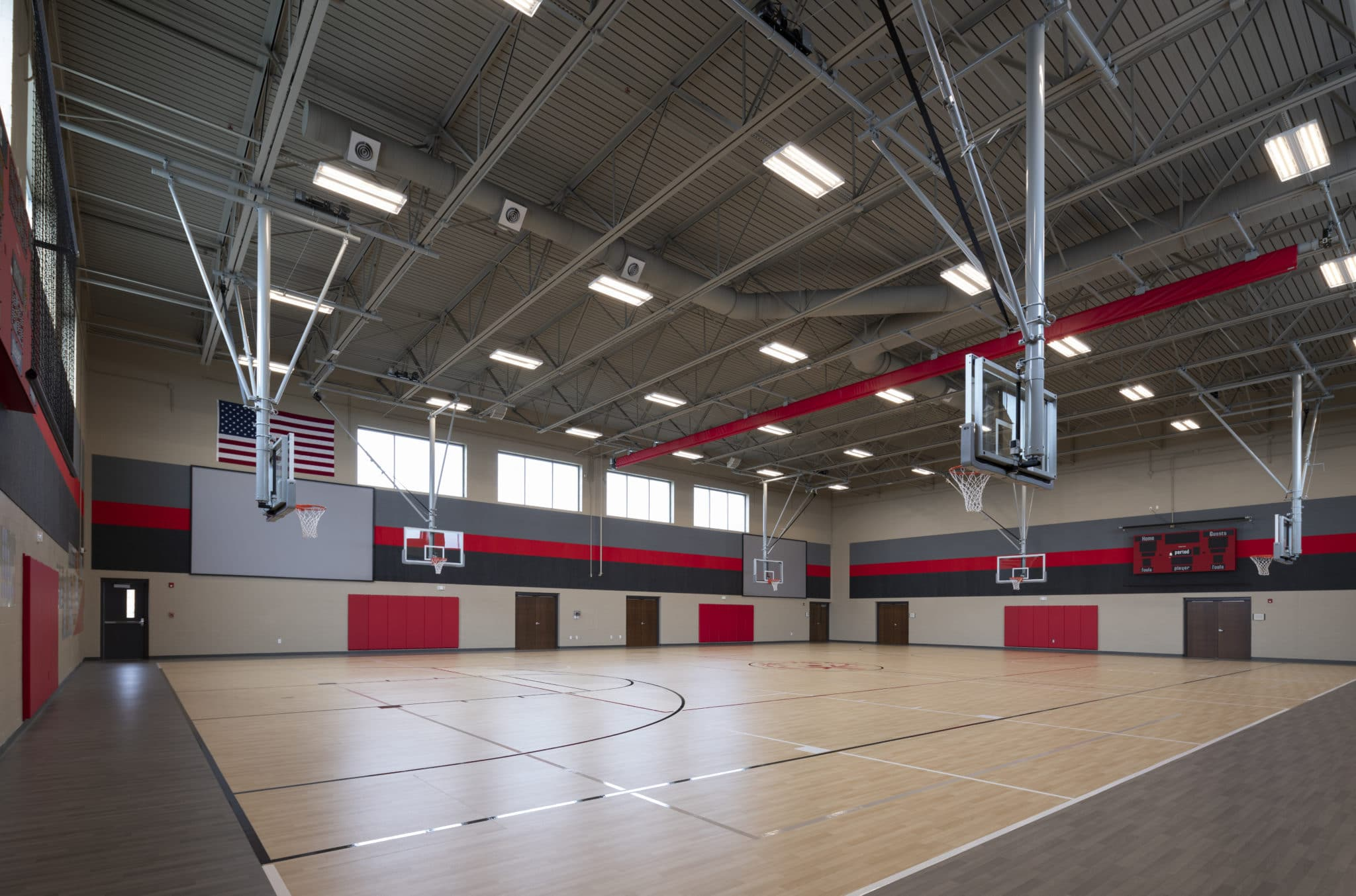 An interior photo of the gymnasium with six basketball hoops