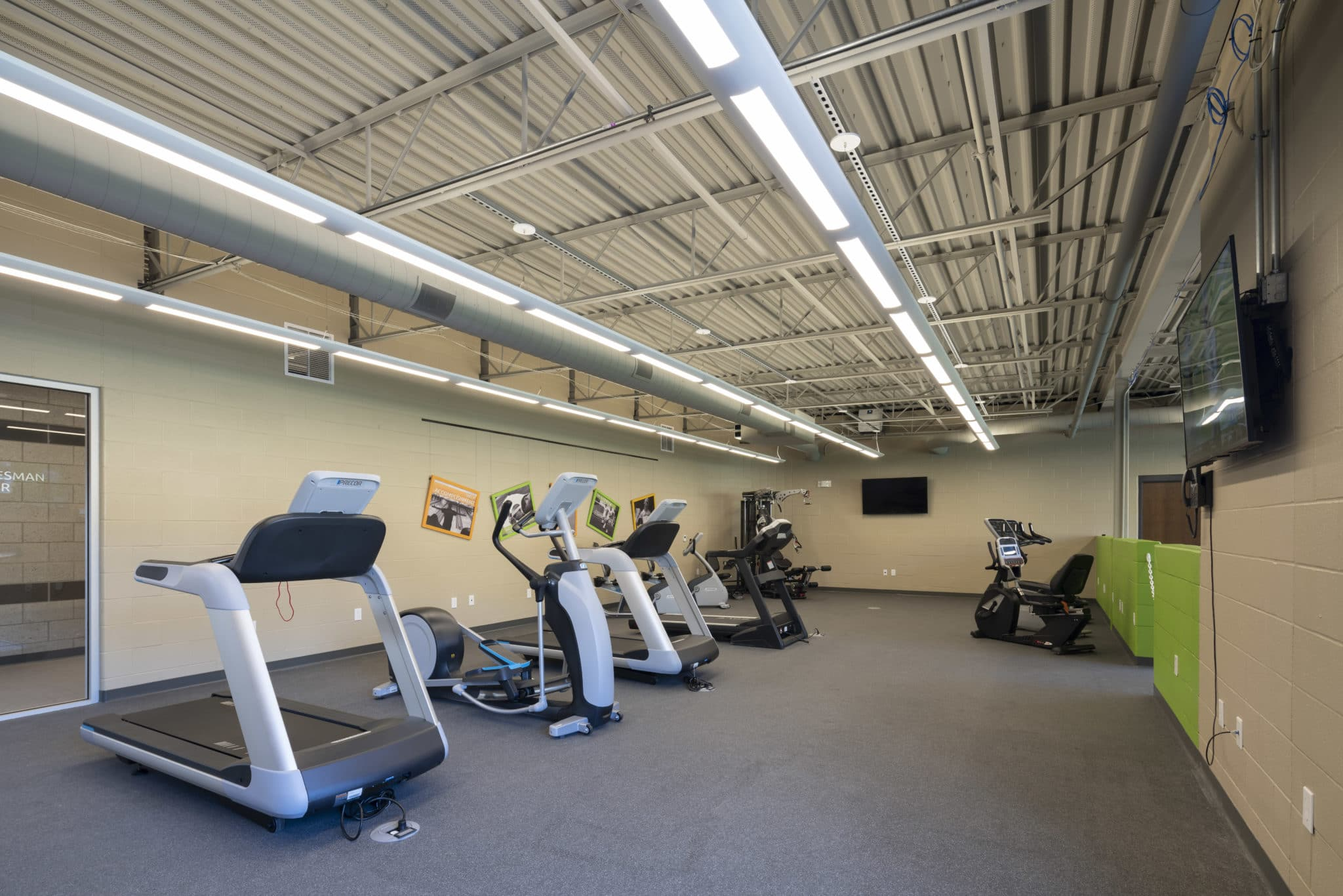 Treadmills, ellipticals, and stationary bicycles in the fitness center at the Training for Life Campus