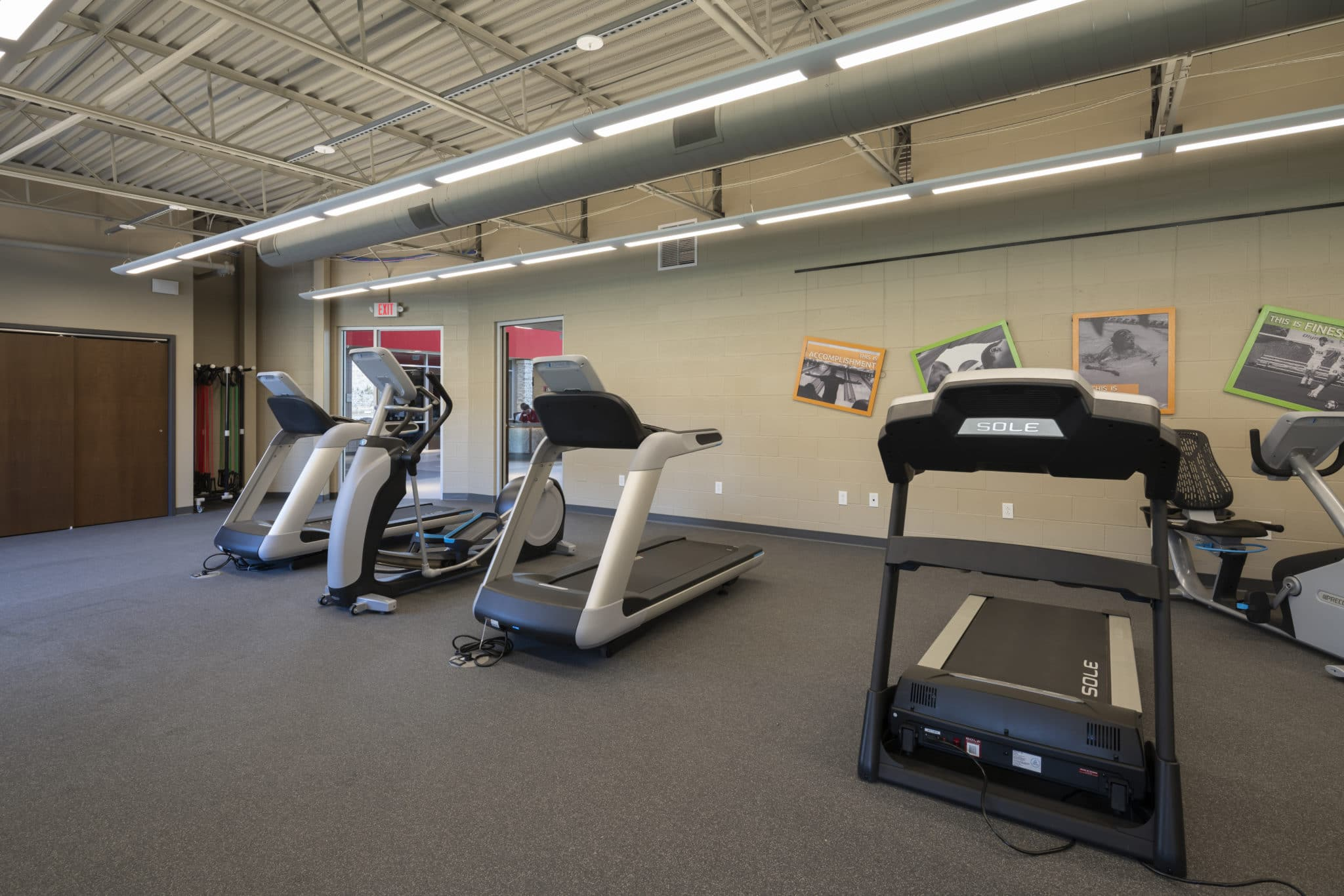 Ellipticals and treadmills in the fitness center at the Training for Life Campus