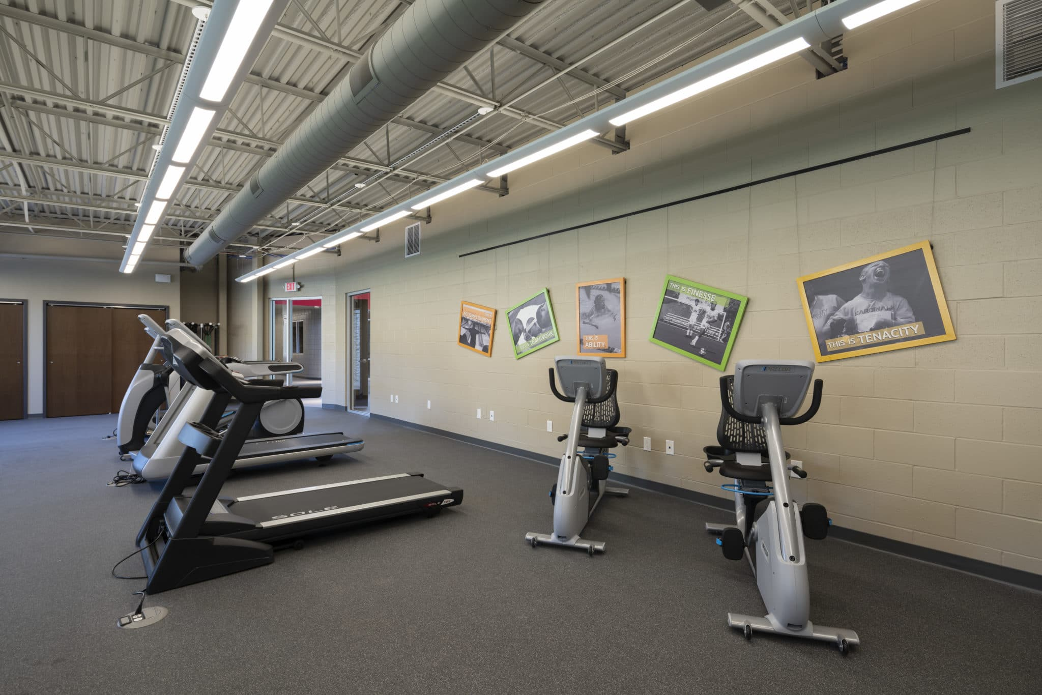 Treadmills and stationary bicycles in the fitness center at the Training for Life Campus