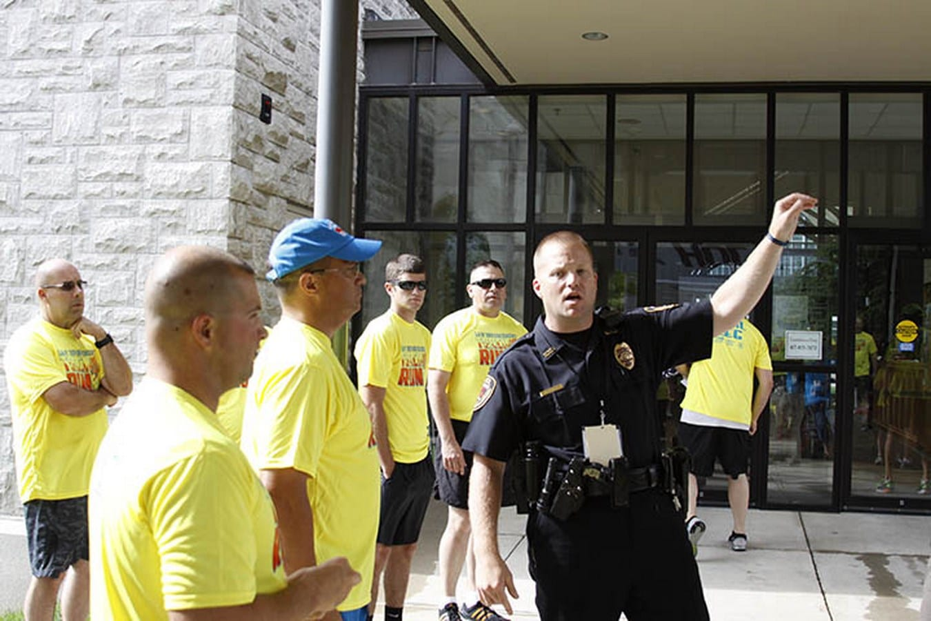 Sargent Mark Priebe in uniform gives direction to his other law enforcement officers before a Torch Run