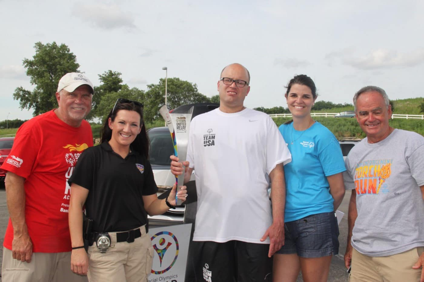 Lee's Summit Police Officer Amanda Geno, second from left, will join Missouri Special Olympics athlete Brett Harper for the final leg of the Law Enforcement Torch Run to the 2022 World Games in Kazan, Russia.