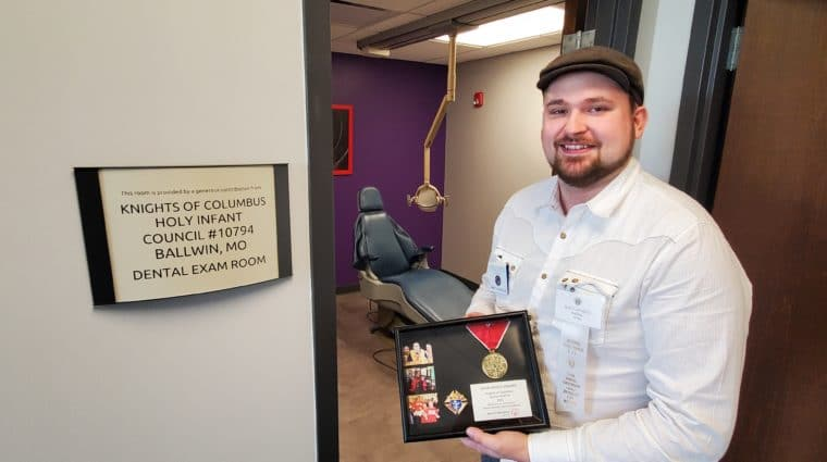 Matt LaCaille stands in front of the dental exam room at Special Olympics Missouri's Training for Life Campus.