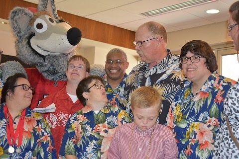 Kansas City Chiefs Coach Andy Reid stands for photos with K.C. Wolf and a group of Special Olympics Missouri athletes.