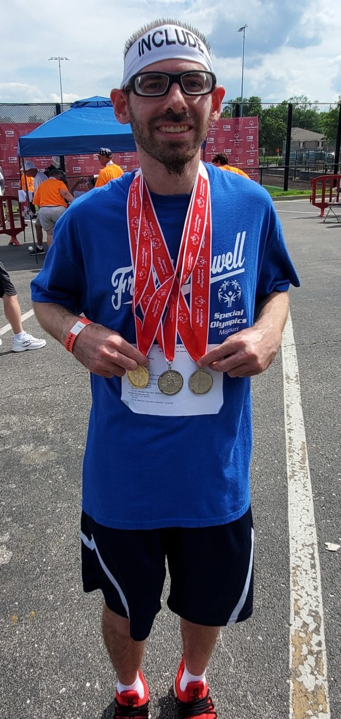 Brent Kampert, Special Olympics Missouri track and field athlete, shows the three medals - two gold and one silver - that he won at the 2021 State Summer Games in Columbia, Mo.