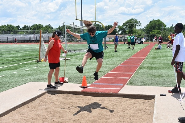St. Joseph athlete Leah Shoemaker competes in the running long jump at the Special Olympics Missouri 2021 State Summer Games.