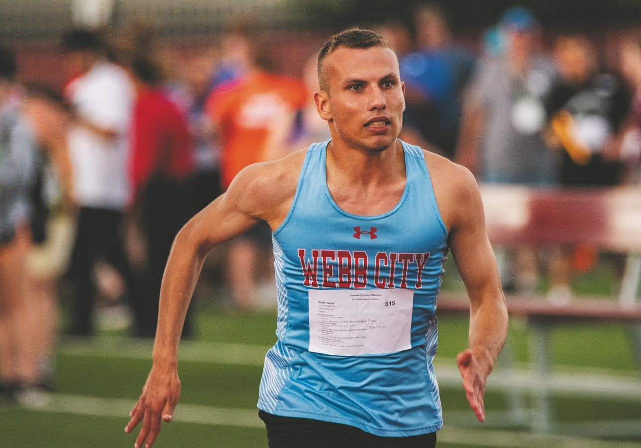 An athlete from Webb City runs in a track and field race with a look of focus on their face